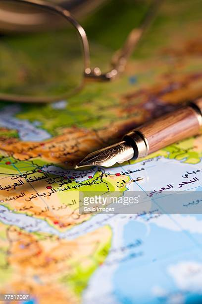 Arabic map with pen and reading glasses. United Arab Emirates