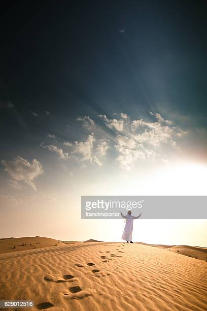 arabic sheik on the deser praying