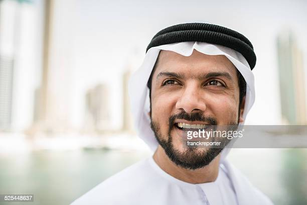 arabic sheik portrait laughing on dubai marina
