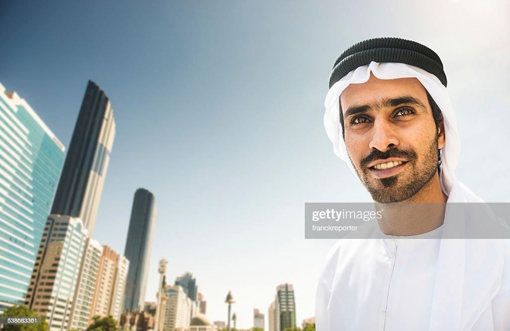arabic sheik portrait with the Abu Dhabi Skyline