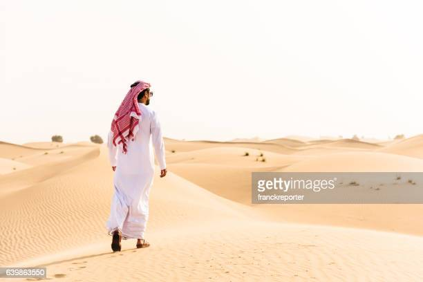 arabic sheik walking on the desert