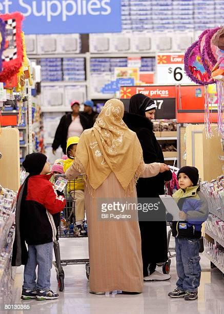 Arabic women shop at a new multilingual WalMart that will stock the largest selection of Middle Eastern food of any WalMart in the nation March 5...