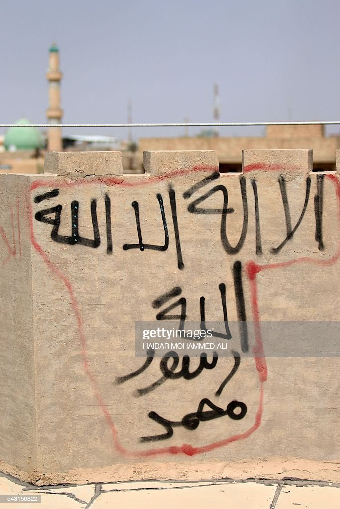 'There is no God but God and Mohammed is the Prophet of God' is seen in Fallujah, 50 kilometres (30 miles) from the Iraqi capital Baghdad, after Iraqi forces retook the embattled city from the Islamic State group on June 26, 2016. Iraqi Prime Minister Haider al-Abadi urged all Iraqis to celebrate the recapture of Fallujah by the security forces and vowed the national flag would be raised in Mosul soon. While the battle has been won, Iraq still faces a major humanitarian crisis in its aftermath, with tens of thousands of people who fled the fighting desperately in need of assistance in the searing summer heat. ALI