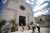 ArabIsraeli Christians leave following an Arabic mass lead by Parish priest Father Abdou in the Saint Joseph's Latin Parish in the Mediterranean...