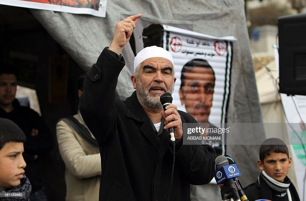 Arab-Israeli Islamist leader Sheikh Raed Salah speaks at a demonstration in support with Palestinian prisoners held in Israeli jails, some of whom are observing a hunger strike, in the West Bank city of Ramallah on February 11, 2013. AFP PHOTO/ABBAS MOMANI