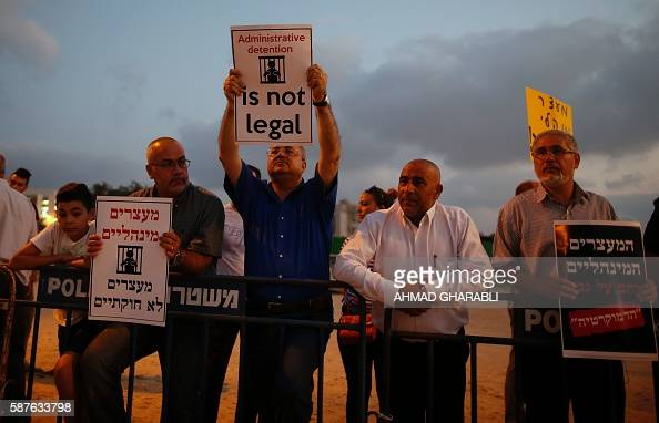 ArabIsraeli Knesset member Ahmad alTibi holds a poster against administrative detention during a demonstration in support of Palestinian prisoner...