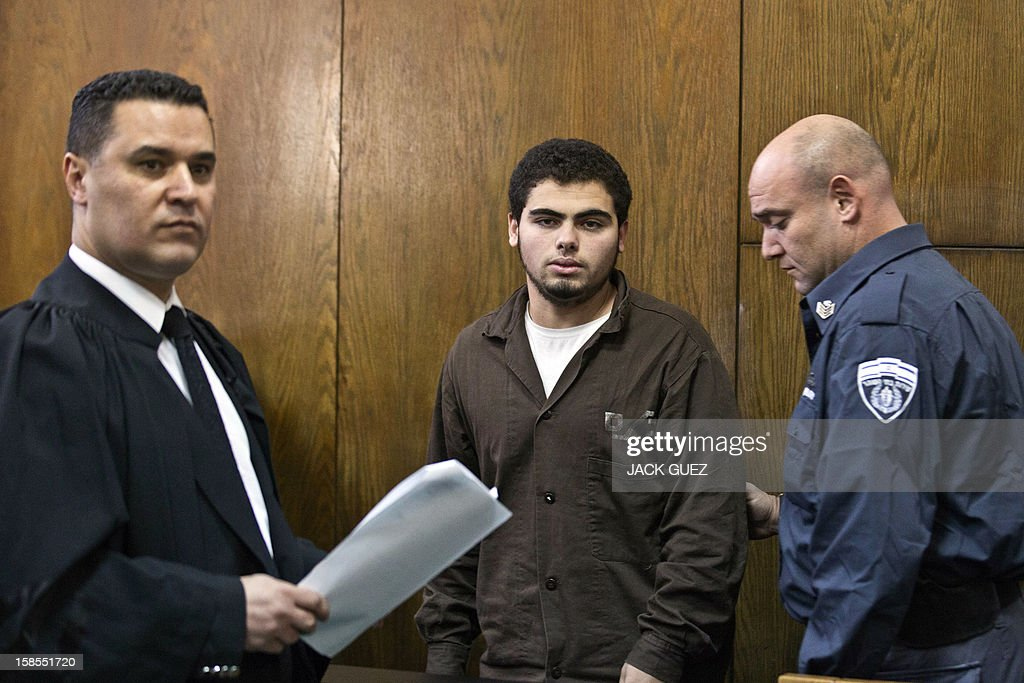 Arab-Israeli Mohammed Mafarja (C), a suspect in the November 21 Tel Aviv bus bombing, arrives at the Tel Aviv magistrates court on December 19, 2012. The 18-year-old was indicted for planting a bomb on a bus in Tel Aviv last month that wounded 29 people during the eight-day conflict between Israel and Gaza.