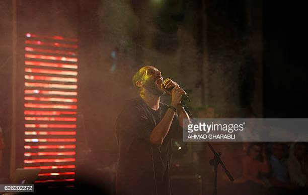 ArabIsraeli rapper Tamer Nafar performs onstage during a festival in the northern ArabIsraeli town of Sakhnin on October 23 2016 Nafar from the...