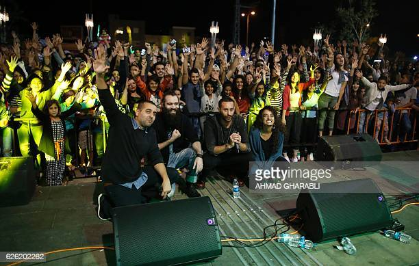 ArabIsraeli rapper Tamer Nafar poses onstage for a picture with audience members after performing during a festival in the northern ArabIsraeli town...