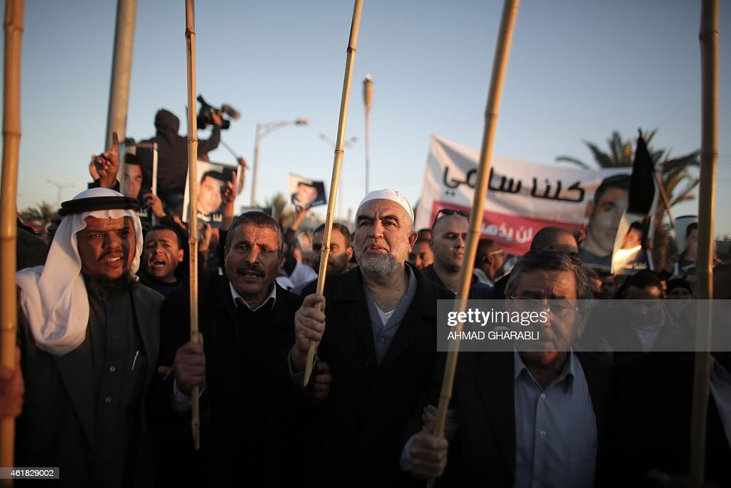 Arab-Israeli <a gi-track='captionPersonalityLinkClicked' href=/galleries/search?phrase=Sheikh+Raed+Salah&family=editorial&specificpeople=2108548 ng-click='$event.stopPropagation()'>Sheikh Raed Salah</a> (2nd-R), leader of the radical northern wing of the Islamic Movement in Israel, takes part in a rally in the southern Israeli Bedouin city of Rahat on January 20, 2015, to condemn the death of Sami al-Jaar (portrait), 22, who died of a gunshot wound last week during a police drug raid on the Negev Bedouin town. Leaders of Israel's 1.7 million Arabs declared a general strike throughout the country in protest at the recent deaths of two Bedouin men in confrontations with police. AFP PHOTO / AHMAD GHARABLI