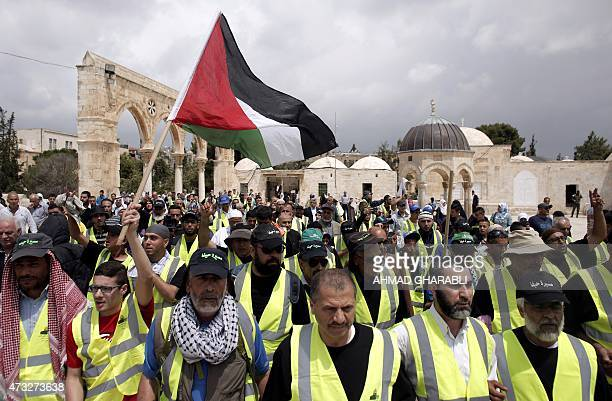 ArabIsraeli supporters of Raed Salah head of the Islamic Movement wave a Palestinian flag upon their arrival at the AlAqsa mosques compound in east...