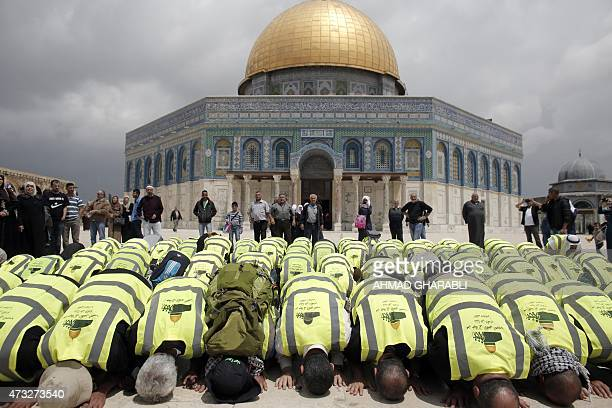 ArabIsraeli supporters of Raed Salah head of the Islamic Movement pray in front of the Dome of the Rock mosque following their arrival at the AlAqsa...