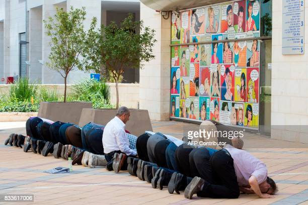 ArabIsraeli supporters of Sheikh Raed Salah leader of the radical northern branch of the Islamic Movement in Israel pray during a gathering in...