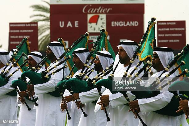 Arabs in traditional clothing play bag pipes during the 3rd Cartier Dubai Polo Challenge at Desert Palm Polo Ground on March 28 2008 in Dubai United...