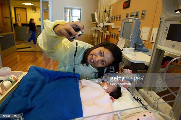 Araceli Hurtado takes a picture of her baby Alita in her new room in the new wing at the Children's Hospital Los Angeles on July 17 2011 192 patients...