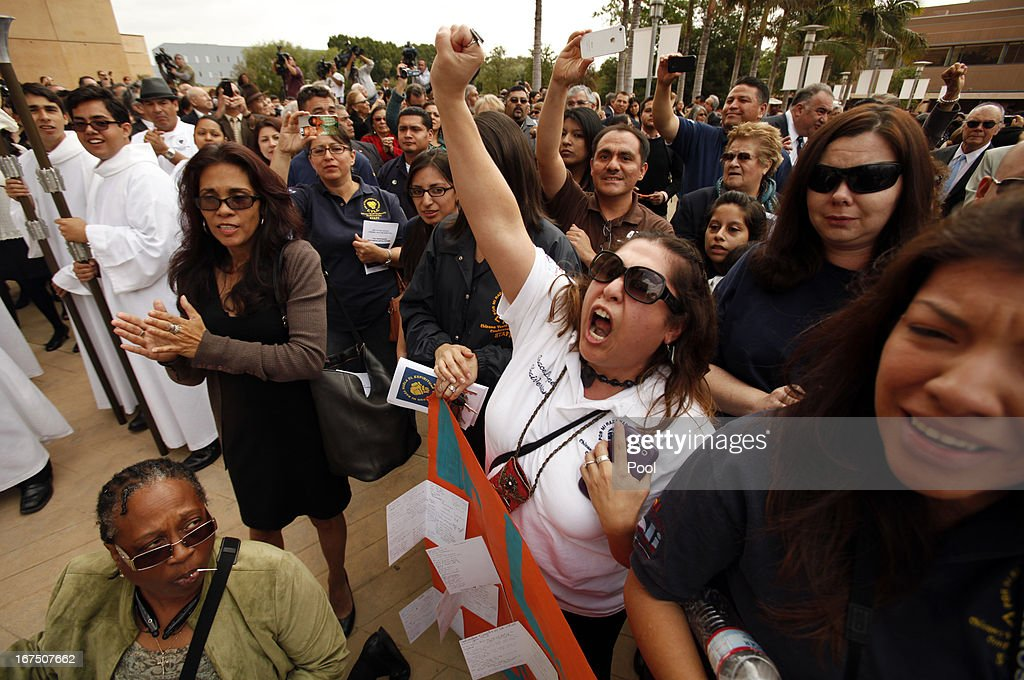 Araceli Lopez (C), 38, who worked with Sal Castro at the Chicano Youth Leadership Conference, Inc. yells out as doves are released by family at the conclusion of the funeral mass for the former teacher Castro at the Cathedral of Our Lady of Angels on April 25, 2013 in Los Angeles, California. Sal Castro was one of the leaders of the 1968 Chicano student walkouts, a protest for better schools that is considered the start of the Chicano movement.