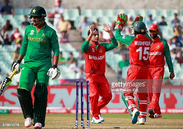 Arafat Sunny of Bangladesh celebrates with teammates after bowing out Sharjeel Khan of Pakistan during the ICC World Twenty20 India 2016 match...