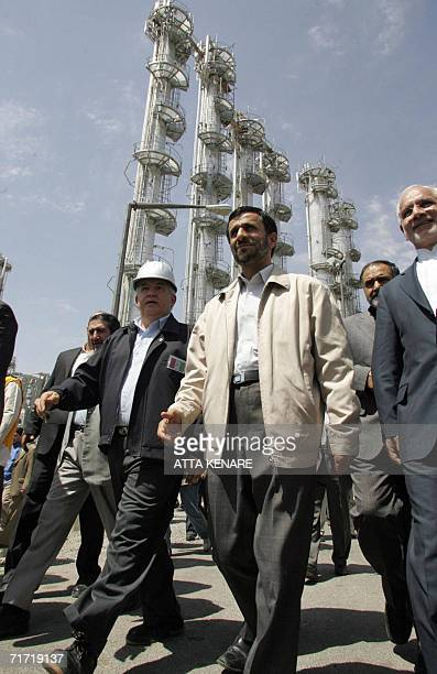 Iranian President Mahmoud Ahmadinejad walks during the opening ceremony of a heavy water plant in Arak 320 kms south of Tehran 26 August 2006...