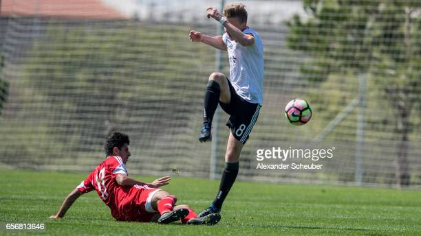 Aram Khamoyan of Armenia challenges Erik Majetschak of Germany during the UEFA U17 elite round match between Germany and Armenia on March 23 2017 in...