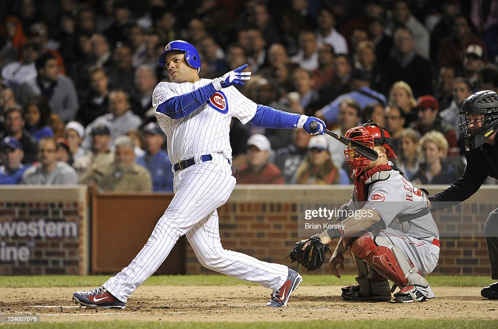 <a gi-track='captionPersonalityLinkClicked' href=/galleries/search?phrase=Aramis+Ramirez&family=editorial&specificpeople=239509 ng-click='$event.stopPropagation()'>Aramis Ramirez</a> #16 of the Chicago Cubs follows through on a two-RBI double scoring teammates Starlin Castro #13 and Reed Johnson #5 during the sixth inning against the Cincinnati Reds at Wrigley Field on September 7, 2011 in Chicago, Illinois.