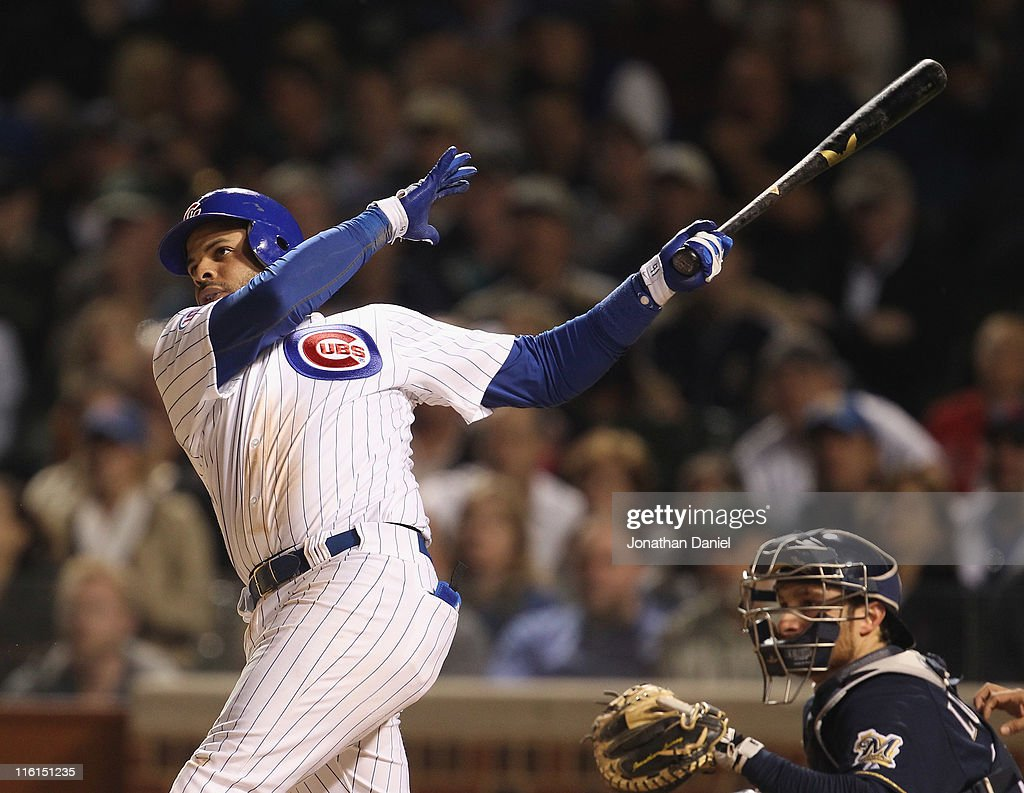 Aramis Ramirez of the Chicago Cubs hits a gametying tworun home run in the 8th inning against the Milwaukee Brewers at Wrigley Field on June 14 2011...