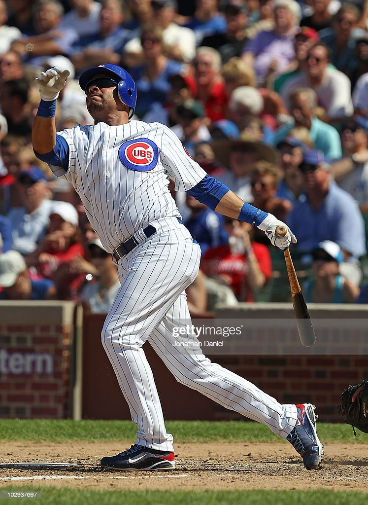 Aramis Ramirez #16 of the Chicago Cubs hits the game-winning home run, a solo shot in the 8th inning, against the Philadelphia Phillies at Wrigley Field on July 16, 2010 in Chicago, Illinois. The Cubs defeated the Phillies 4-3.