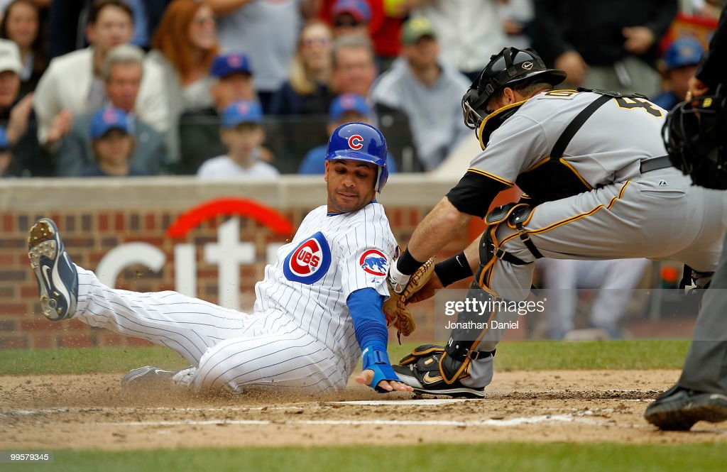Aramis Ramirez of the Chicago Cubs is tagged out at the plate by Ryan Doumit of the Pittsburgh Pirates in the 3rd inning at Wrigley Field on May 15...
