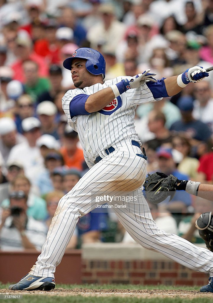Aramis Ramirez of the Chicago Cubs makes a hit during the game against the Chicago White Sox on July 1 2006 at Wrigley Field in Chicago Illinois