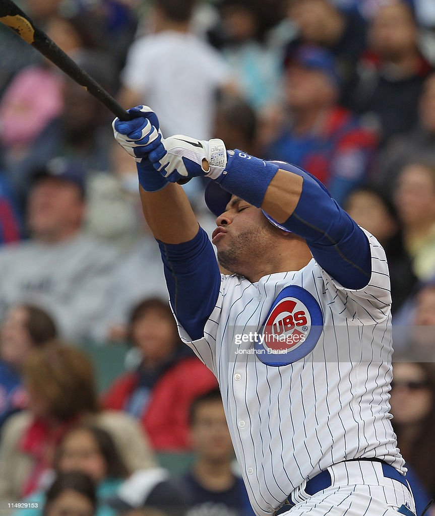 Aramis Ramirez #16 of the Chicago Cubs reacts after swinging and missing a pitch against the Pittsburgh Pirates at Wrigley Field on May 29, 2011 in Chicago, Illinois. The Cubs defeated the Pirates 3-2.