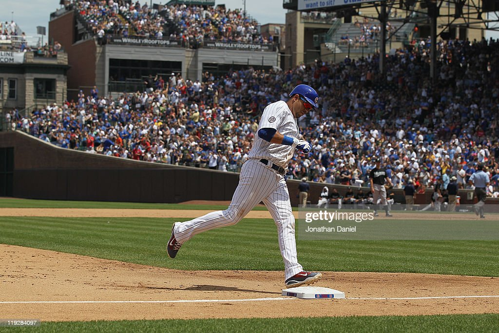Aramis Ramirez of the Chicago Cubs runs the bases after hitting a threerun home run in the 6th inning against the Florida Marlins at Wrigley Field on...