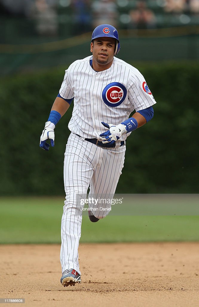 Aramis Ramirez of the Chicago Cubs runs the bases after hitting the 300th home run of his career against the Chicago White Sox at Wrigley Field on...