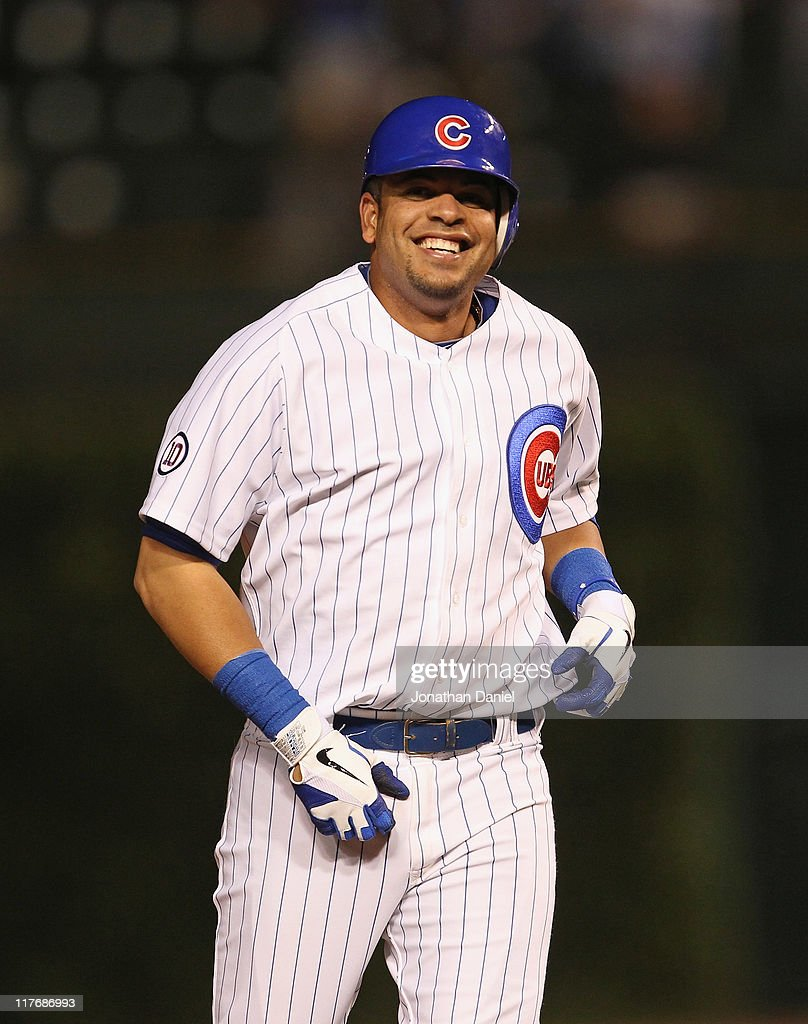 Aramis Ramirez of the Chicago Cubs smiles after getting the gamewinning hit as a pinchhitter in the bottom of the 9th inning against the San...