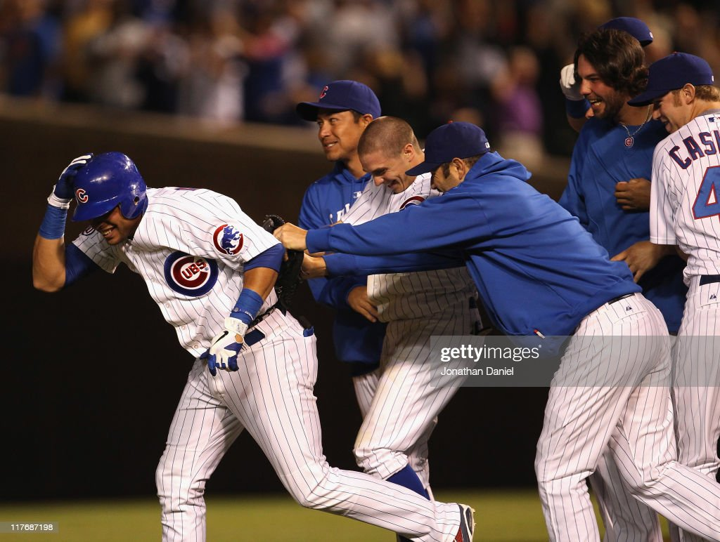 Aramis Ramirez of the Chicago Cubs smiles as he runs away from celebrating teammates after getting the gamewinning hit as a pinchhitter against the...