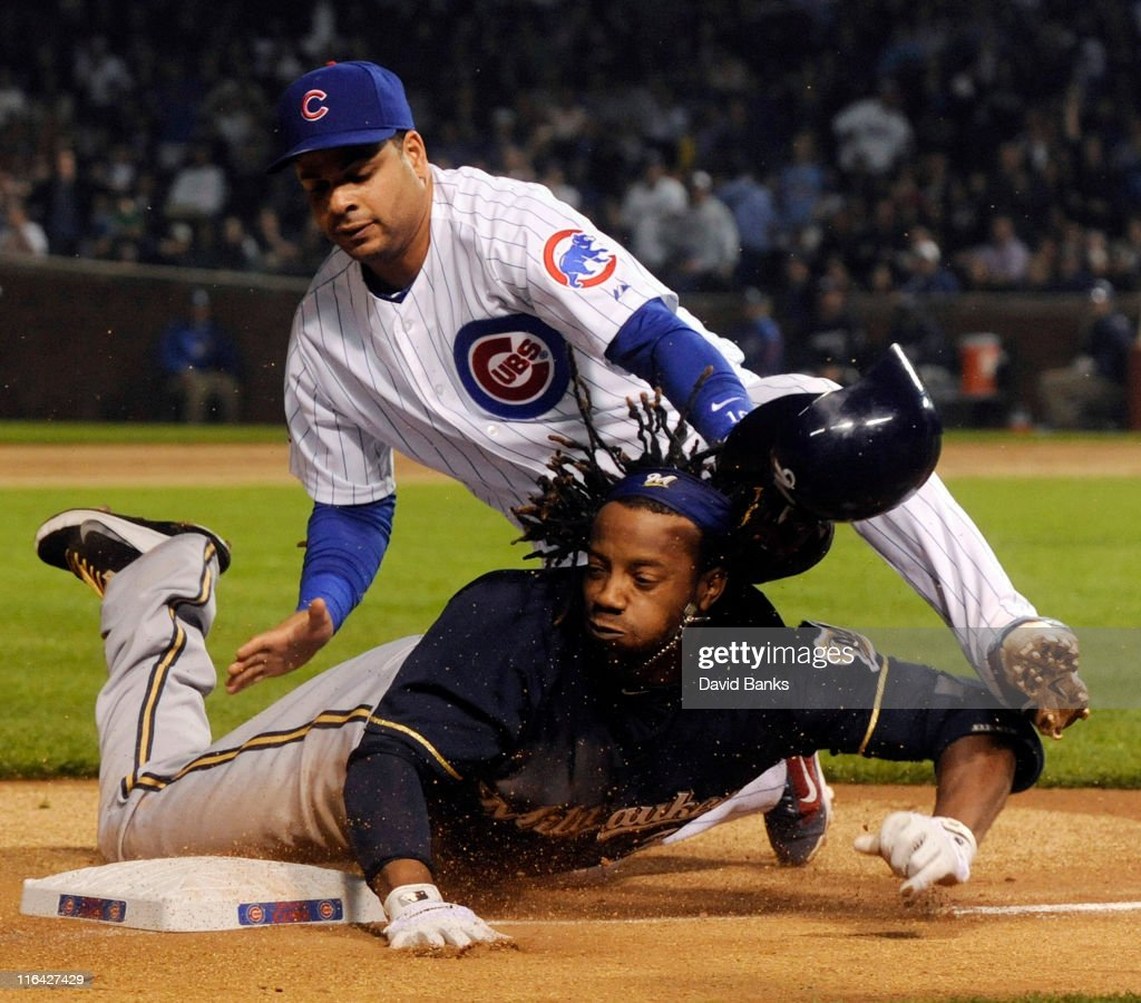 Aramis Ramirez of the Chicago Cubs tags Rickie Weeks of the Milwaukee Brewers out at third base in the third inning on June 15 2011 at Wrigley Field...