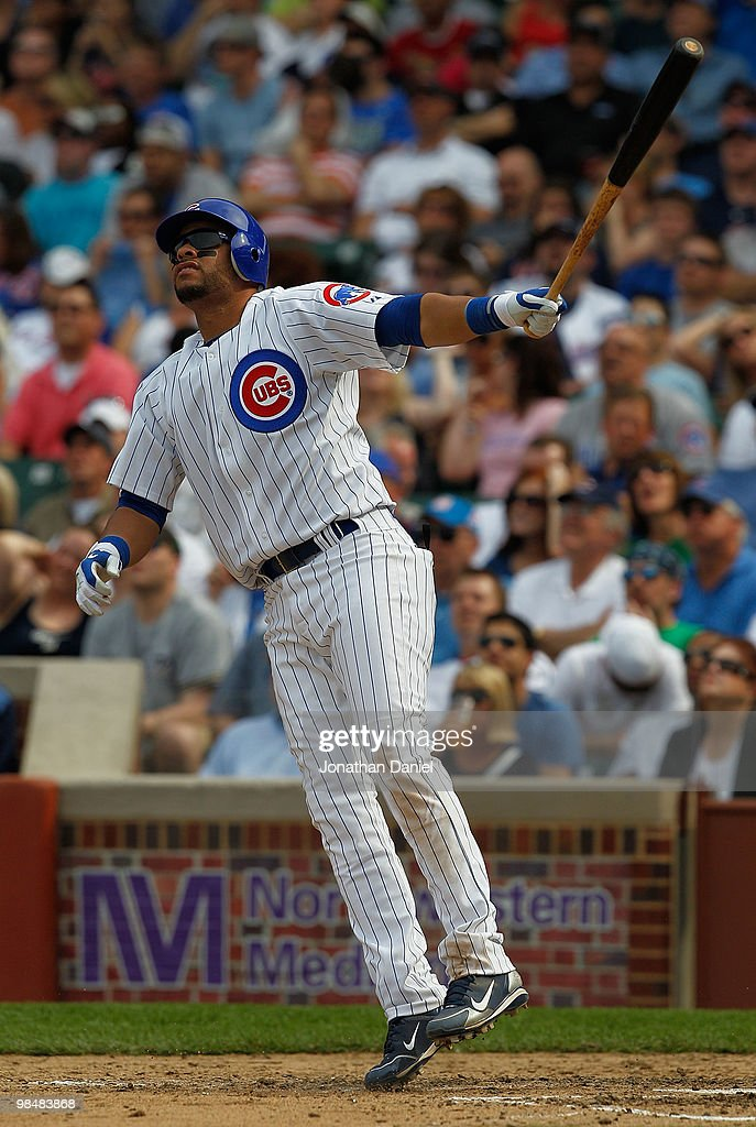 Aramis Ramirez of the Chicago Cubs wearing a number 42 jersey in honor of Jackie Robinson hops after hitting a home run against the Milwaukee Brewers...