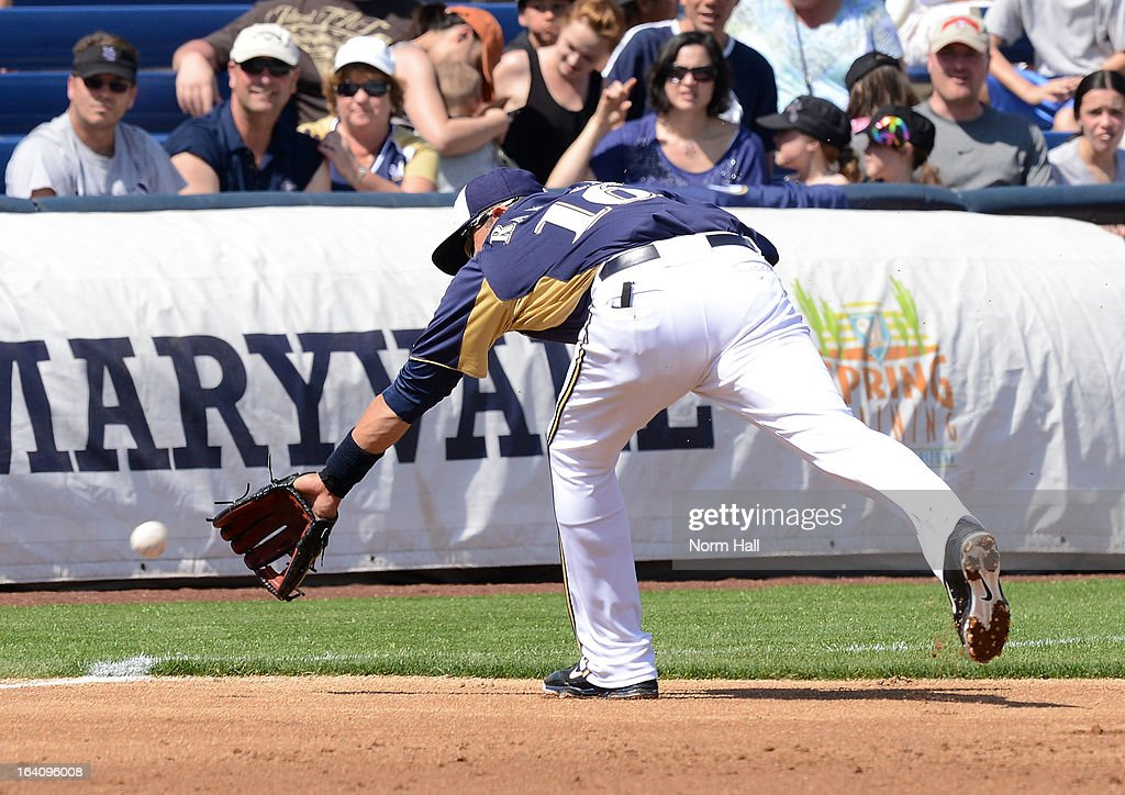 Aramis Ramirez #16 of the Milwaukee Brewers attempts to make a backhanded play on a ground ball against the Los Angeles Angels of Anaheim at Maryvale Baseball Park on March 19, 2013 in Maryvale, Arizona.