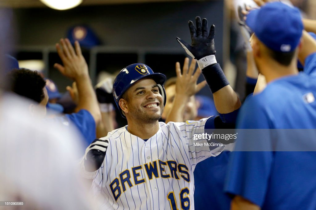 <a gi-track='captionPersonalityLinkClicked' href=/galleries/search?phrase=Aramis+Ramirez&family=editorial&specificpeople=239509 ng-click='$event.stopPropagation()'>Aramis Ramirez</a> #16 of the Milwaukee Brewers celebrates in the dugout after hitting a two-run home run in the bottom of the eighth inning against the Pittsburgh Pirates at Miller Park on August 31, 2012 in Milwaukee, Wisconsin.