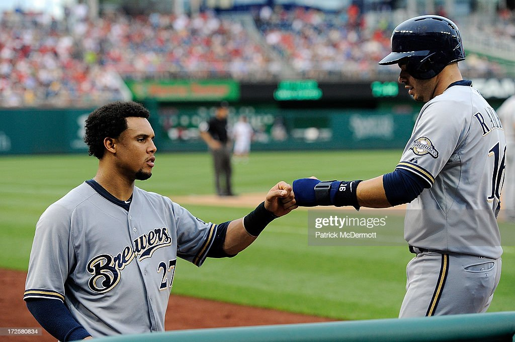 <a gi-track='captionPersonalityLinkClicked' href=/galleries/search?phrase=Aramis+Ramirez&family=editorial&specificpeople=239509 ng-click='$event.stopPropagation()'>Aramis Ramirez</a> #16 of the Milwaukee Brewers celebrates with Carlos Gomez #27 after scoring on a two run RBI triple hit by Logan Schafer #22 during a game against the Washington Nationals at Nationals Park on July 3, 2013 in Washington, DC.