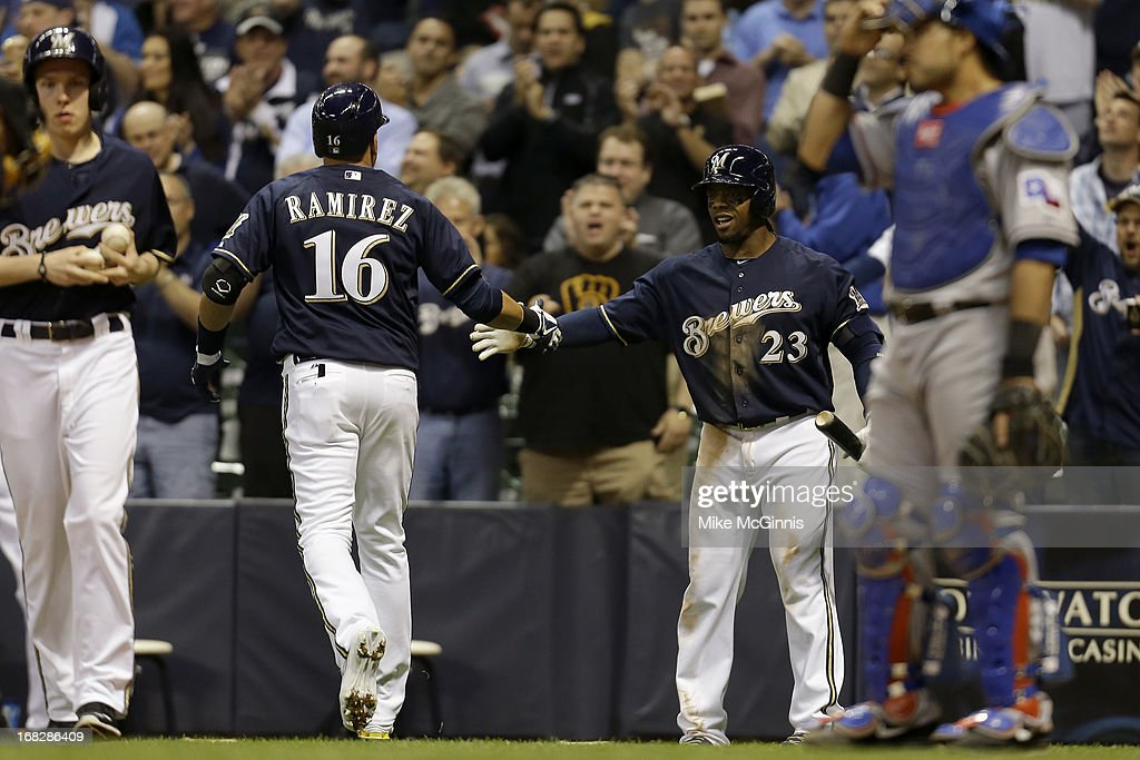 <a gi-track='captionPersonalityLinkClicked' href=/galleries/search?phrase=Aramis+Ramirez&family=editorial&specificpeople=239509 ng-click='$event.stopPropagation()'>Aramis Ramirez</a> #16 of the Milwaukee Brewers celebrates with <a gi-track='captionPersonalityLinkClicked' href=/galleries/search?phrase=Rickie+Weeks&family=editorial&specificpeople=550245 ng-click='$event.stopPropagation()'>Rickie Weeks</a> #23 after hitting a solo home run in the bottom of the seventh inning against the Texas Ranger at Miller Park on May 07, 2013 in Milwaukee, Wisconsin.