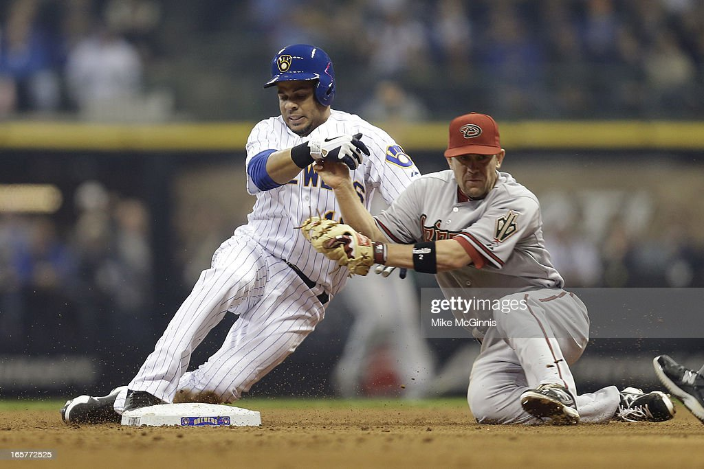 Aramis Ramirez #16 of the Milwaukee Brewers collides with Aaron Hill #2 of the Arizona Diamondbacks while reaching for a double during the bottom of the fourth inning at Miller Park on April 5, 2013 in Milwaukee, Wisconsin.