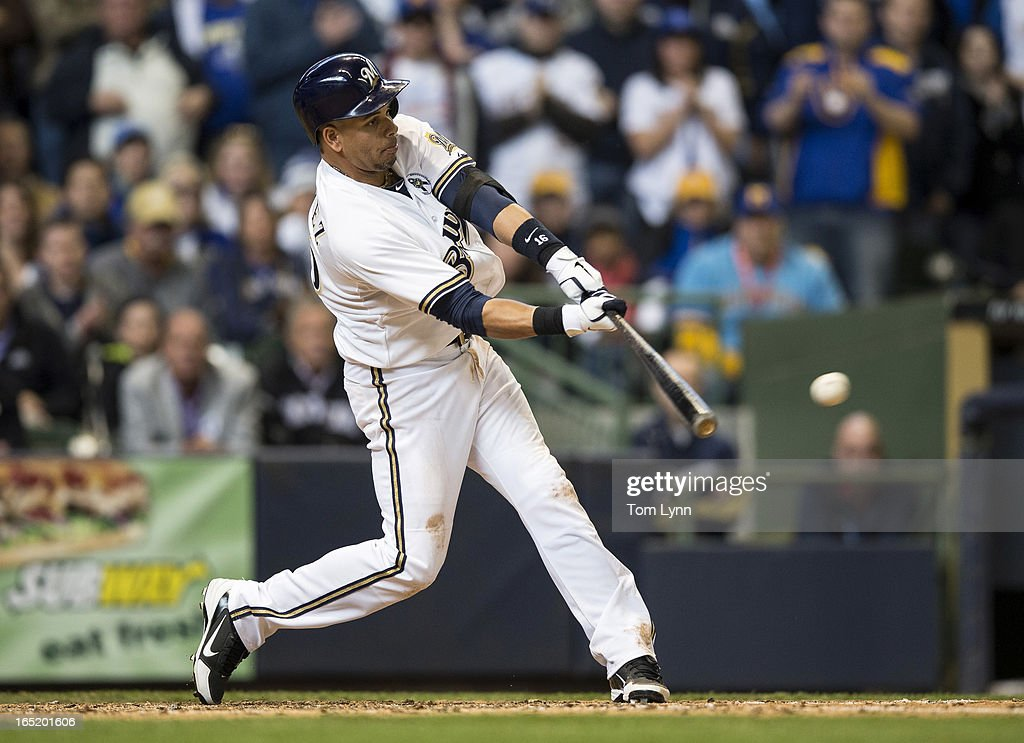 <a gi-track='captionPersonalityLinkClicked' href=/galleries/search?phrase=Aramis+Ramirez&family=editorial&specificpeople=239509 ng-click='$event.stopPropagation()'>Aramis Ramirez</a> #16 of the Milwaukee Brewers connects for a 2 RBI double in the eighth inning against the Colorado Rockies on opening day at Miller Park on April 1, 2013 in Milwaukee, Wisconsin. The Milwaukee Brewers defeated the Colorado Rockier 5-4.