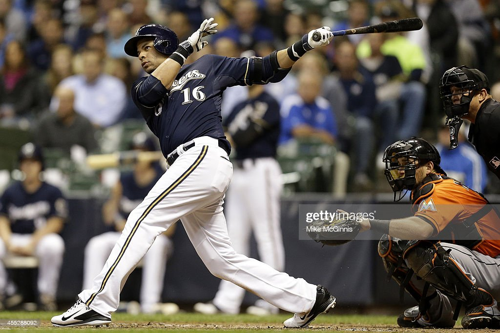 Aramis Ramirez of the Milwaukee Brewers hits an RBI double in the bottom of the third inning against the Miami Marlins at Miller Park on September 11...