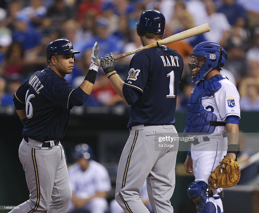 Aramis Ramirez #16 of the Milwaukee Brewers is congratulated by Corey Hart #1 after hitting a home run as Humberto Quintero #33 of the Kansas City Royals looks on during an interleague game in the seventh inning at Kauffman Stadium on June 14, 2012 in Kansas City, Missouri.