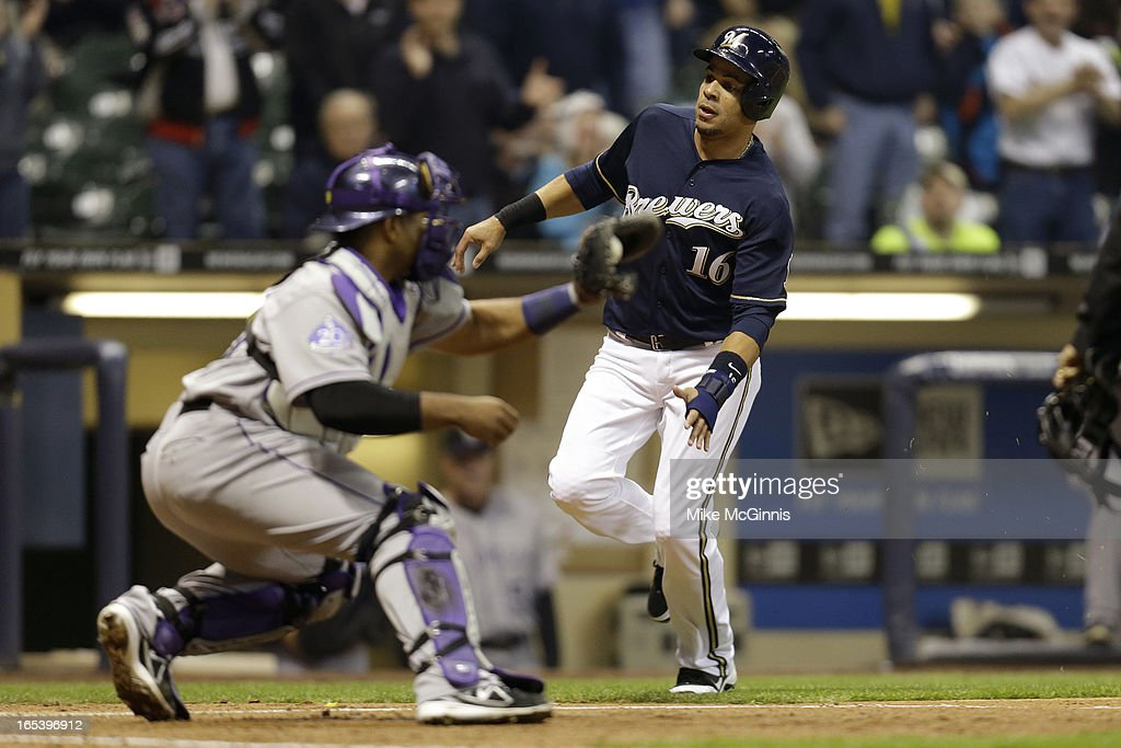 <a gi-track='captionPersonalityLinkClicked' href=/galleries/search?phrase=Aramis+Ramirez&family=editorial&specificpeople=239509 ng-click='$event.stopPropagation()'>Aramis Ramirez</a> #16 of the Milwaukee Brewers is tagged out at the plate by catcher <a gi-track='captionPersonalityLinkClicked' href=/galleries/search?phrase=Wilin+Rosario&family=editorial&specificpeople=5734314 ng-click='$event.stopPropagation()'>Wilin Rosario</a> #20 in the bottom of the third inning against the Colorado Rockies at Miller Park on April 3, 2013 in Milwaukee, Wisconsin.