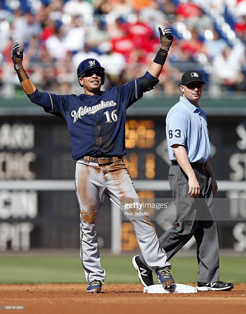 <a gi-track='captionPersonalityLinkClicked' href=/galleries/search?phrase=Aramis+Ramirez&family=editorial&specificpeople=239509 ng-click='$event.stopPropagation()'>Aramis Ramirez</a> #16 of the Milwaukee Brewers raises his arms after hitting a double in the second inning against the Philadelphia Phillies in a MLB baseball game on June 1, 2013 at Citizens Bank Park in Philadelphia, Pennsylvania.