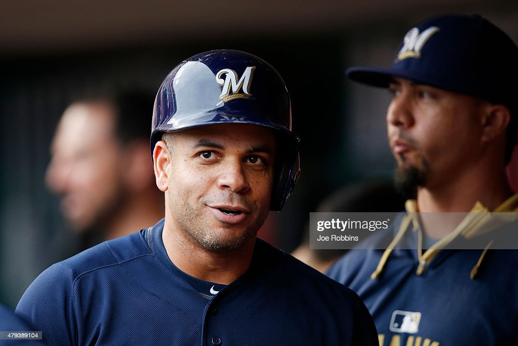Aramis Ramirez of the Milwaukee Brewers reacts in the dugout after hitting a home run in the second inning against the Cincinnati Reds at Great...