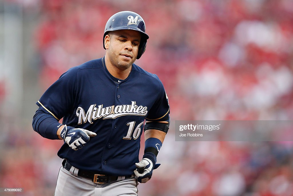 Aramis Ramirez of the Milwaukee Brewers rounds the bases after hitting a home run in the second inning against the Cincinnati Reds at Great American...