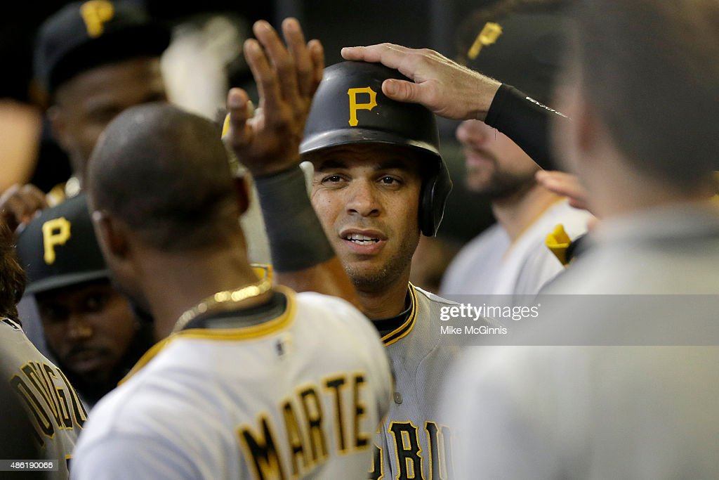 Aramis Ramirez of the Pittsburgh Pirates celebrates in the dugout after hitting a solo home run in the ninth inning against the Milwaukee Brewers at...