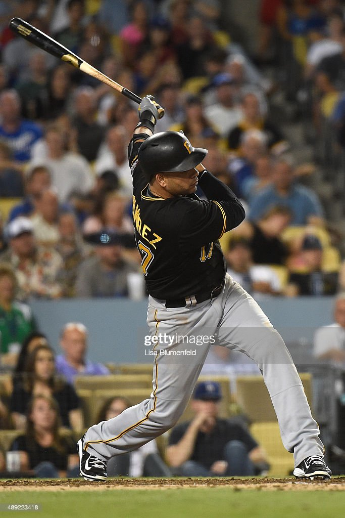 Aramis Ramirez #17 of the Pittsburgh Pirates hits a RBI single in the eighth inning against the Los Angeles Dodgers at Dodger Stadium on September 19, 2015 in Los Angeles, California.