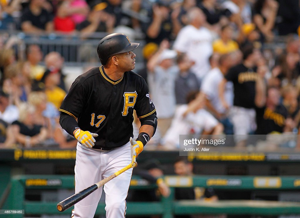 Aramis Ramirez of the Pittsburgh Pirates hits a three run home run in the first inning during the game against the Colorado Rockies at PNC Park on...